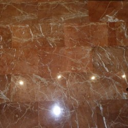 polished tiles in red marble
